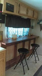 Custom RV Dining Table Converts To Fold Out Murphy Bed