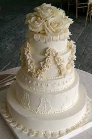 Traditional five tier ivory buttercream classic style wedding cake
