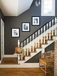 Love The Wall Color A Rich Cocoa Makes Small Entryway Seem Grand Black Semigloss Paint On Railing And Accents Of Crisp White Create Bold