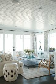 Outstanding Coastal Living Room Sets Traditional Themed White Stripes Ceiling Square Table Light Grey Patterned Rug