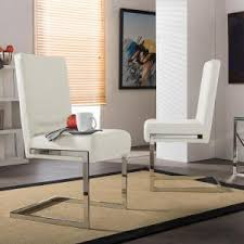 baxton studio toulan white faux leather upholstered dining chairs