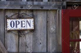 open sign on tiles wooden door st augustine florida