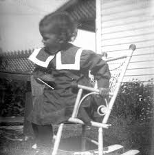Theodore Taylor Bending Over In Rocking Chair To Pet Cat ...