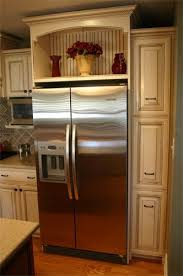 Beadboard Panel Slides Open To Reveal A Hidden Storage Area Above The Refrigerator Kitchen Cabinets DecorOpen