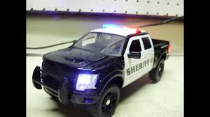Custom 1/24th Scale JADA Diecast FORD RAPTOR Sheriff Truck With ... Jada Diecast Metal 124 Scale Just Trucks 1999 Ford F150 Svt Shop Maisto F350 127 Truck With 2004 Flhtpi Cek Harga Welly 19834 F100 Tow 1956 Forrest Amazoncom Beyond The Infinity 0608 1940 Fire Texaco Red Pickup Black 118 Model By Motor Max 73170 New 125 Car By First Dimana Beli M2 Machines 1960 Vw Double Cab John Deere Vintage Industrial Sales Company Decal Hd Harley Davidson 1948 F1 Motorcycle 2001 Xlt Flareside Supercab Off Road White 1 Ford Transit Rac Recovery Truck 176 Scale Model