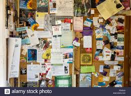 Chaotic Display Of Business Adverts On A Noticeboard UK