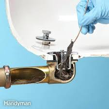 clogged kitchen sink drain home remedy pipe use baking soda
