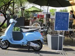 Coffee Shop Exterior Urban Beans Vintage Blue Vespa Handwritten Patio Welcome Sign