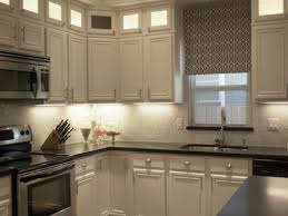 White Cabinets Dark Gray Countertops by White Kitchen Cabinets With Black Countertops