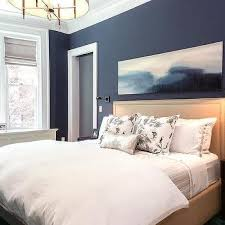 Navy Bedroom Walls With Beige Nailhead Headboard