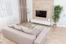 wohnzimmer mit und geführtem fernseher an der holzwand stockfoto und mehr bilder architektur