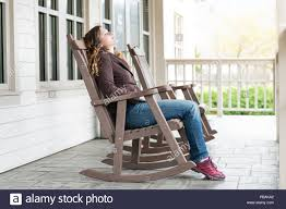 Young Woman Sitting On Reclining, Rocking Chair, Recliner, Rocker By ... Vis Vis Club Chairrocking Chair Trib Custom Rocking Chairs Comfortable Refined And Elegant Gary People Relaxation Retirement Rocking Stock Photos The Peoples Fredericia Chair J16 Eames Is Not Just For Babies Old People Chairish Two Amazoncom Adults Heavy Outdoor Indoor Rar Green Check Out Costway Patio Glider Bench Double 2 Person Loveseat Armchair Backyard New Shopyourway Order A Custom Hand Made Wooden In Uk Ireland Comfortable Chairs By Weeks Company