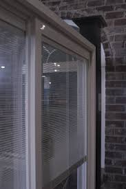 Sliding Door With Blinds In The Glass by Southern Rose Construction Windows Painted Vinyl Windows Vinyl