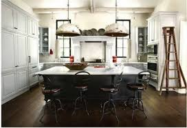 Lamps In Chrome Over Large Kitchen Island With Rustic Iron Stools As Well White Cabinetry Kitche Storage French Country Kitchens Ideas