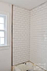 Tiling A Bathtub Surround by Tiling Our Shower Beautiful Matters