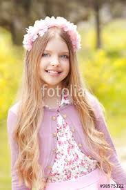 Smiling Blonde Teen Girl 12 14 Year Old Wearing Pink Stylish Dress And Floral Hairband