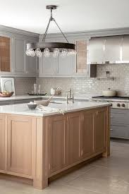 beautiful kitchen features gray shaker cabinets paired with white