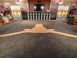ut dkr memorial stadium locker room branding the floor