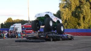 100 Monster Trucks Video Trucks Crushing Old Cars At A Stunt Show Stock