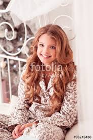 smiling teen 10 12 year old wearing pajamas in room over
