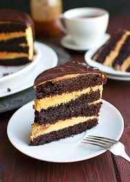Rustic Looking Dark Chocolate Cake With Pumpkin Buttercream And A Caramel Filling