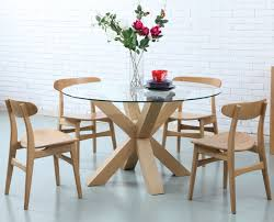 Raymour And Flanigan Round Dining Room Tables by Oscar Round Dining Table Glass Solid Oak 130cm Diameter
