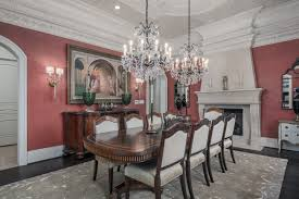 Victorian Dining Table Pearls Chandeliers Pink Walls White Dove Chairs Area Rug Wall Sconces Fireplace Arched
