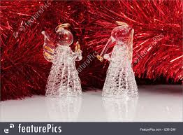 Holidays Two Decorative Glass Angel And Christmas Tree Tinsel On White With Reflections