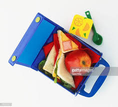 Open Lunch Box Containing Red Apple And Triangular Sandwiches View From Above