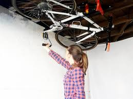 Ceiling Bike Rack For Garage by The Hide A Ride Ceiling Bike Rack Allows Users To Securely Store A