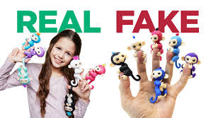 As You Can See The Fakes Are Eerily Similar To Fingerlings But Colored Slightly Different And Sometimes Feature Plastic Hair Unblinking Eyes