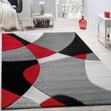wohnzimmer teppich modern geometrische muster rot