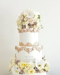 A 3 Tier Rustic Themed Wedding Cake With Fresh Flowers