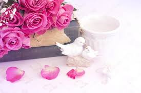 Figurines Wedding Doves In Love Valentine Bouquet Of Pink Roses On Old Books Floral Background Is Tenderness Vintage Retro Selective Soft Focus Photo