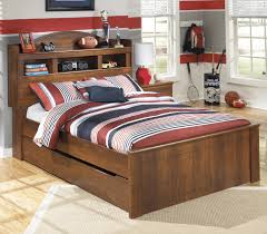 full bookcase bed with trundle under bed storage unit by signature