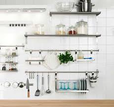 Bright Kitchen With Stainless Steel Shelves