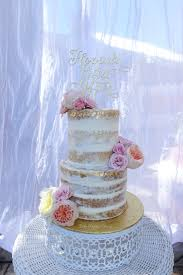 Naked Wedding Cake With Gold Leaf And Fresh Flowers On Opulent Treasures White Round Metal Stand Moroccan Jeweled