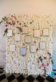 Rose Flower Wall With Framed Seating Charts