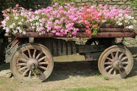 This Wooden Farm Equipment Makes For A Rustic Charming And Large Planter