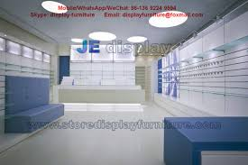 Pharmacy Store Furnitre In Interior Design White Counters And Tempered Glass Shelves For Display With Storage Cabinet