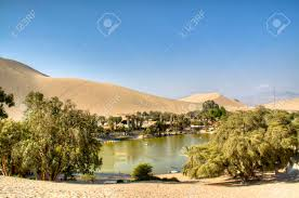 100 L Oasis The Oasis Of Huacachina In The Desert Of Ica Peru