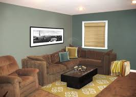 Brown And Teal Living Room by Putting The