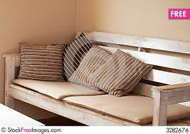 Wooden Couch With Cushions