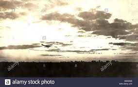 100 Flying Cloud Camp An Evening Scene Aircraft Flying At Sunset Probably Near