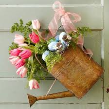 Recycling Watering Can For Easter Decoration With Eggs And Spring Flowers