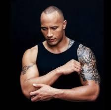 Celebrity Tribal Arm Tattoo Design In Black For Men