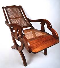 19th Century British Colonial Reclining Chair For Sale At 1stdibs An Early 20th Century American Colonial Carved Rocking Chair H Antique Hitchcock Style Childs Black Bow Back Windsor Rocking Chair Dated C 1937 Dimeions Overall 355 X Vintage Handmade Solid Maple S Bent Bros Etsy Cuban Favorite Inside A Colonial House Stock Photo Java Swivel With Cushion Natural 19th Century British Recling For Sale At 1stdibs Wood Leather Royal Novica Wooden Chairs Image Of Outdoors Old White On A Porch With Columns Rocker 27 Kids
