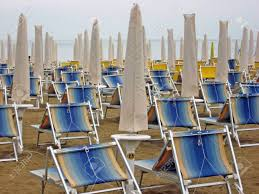 100 Marine Folding Deck Chairs Closed Umbrellas And On A Deserted Beach In Winter Stock