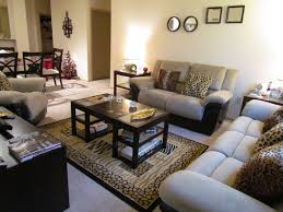 Cheetah Print Bedroom by Living Room Accented With Cheetah Print Throw Pillows And Rug