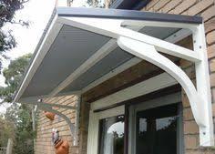 Metal & wood awning rain cover Interior Barn Doors